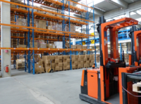 stand-up forklift in warehouse